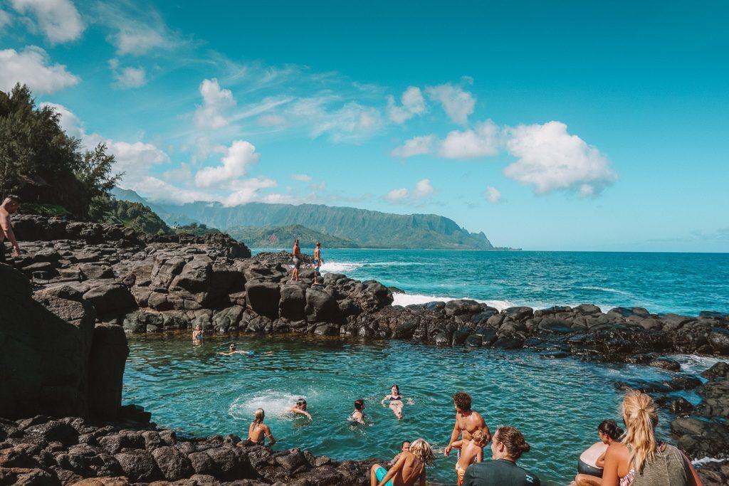 People playing in the Queens Bath natural pool.  Kauai Hawaii